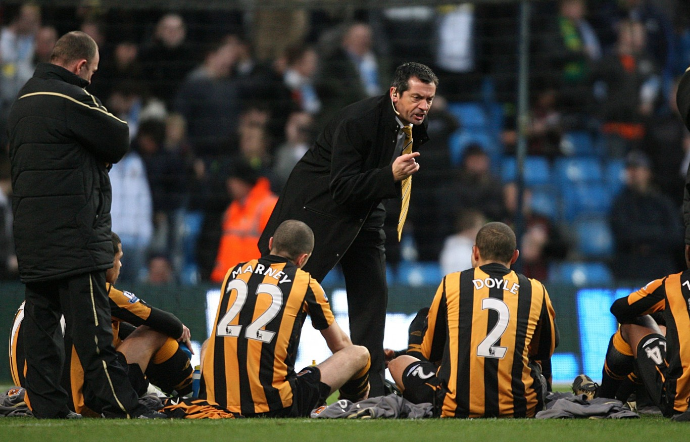 Phil Brown gives team talk on the pitch