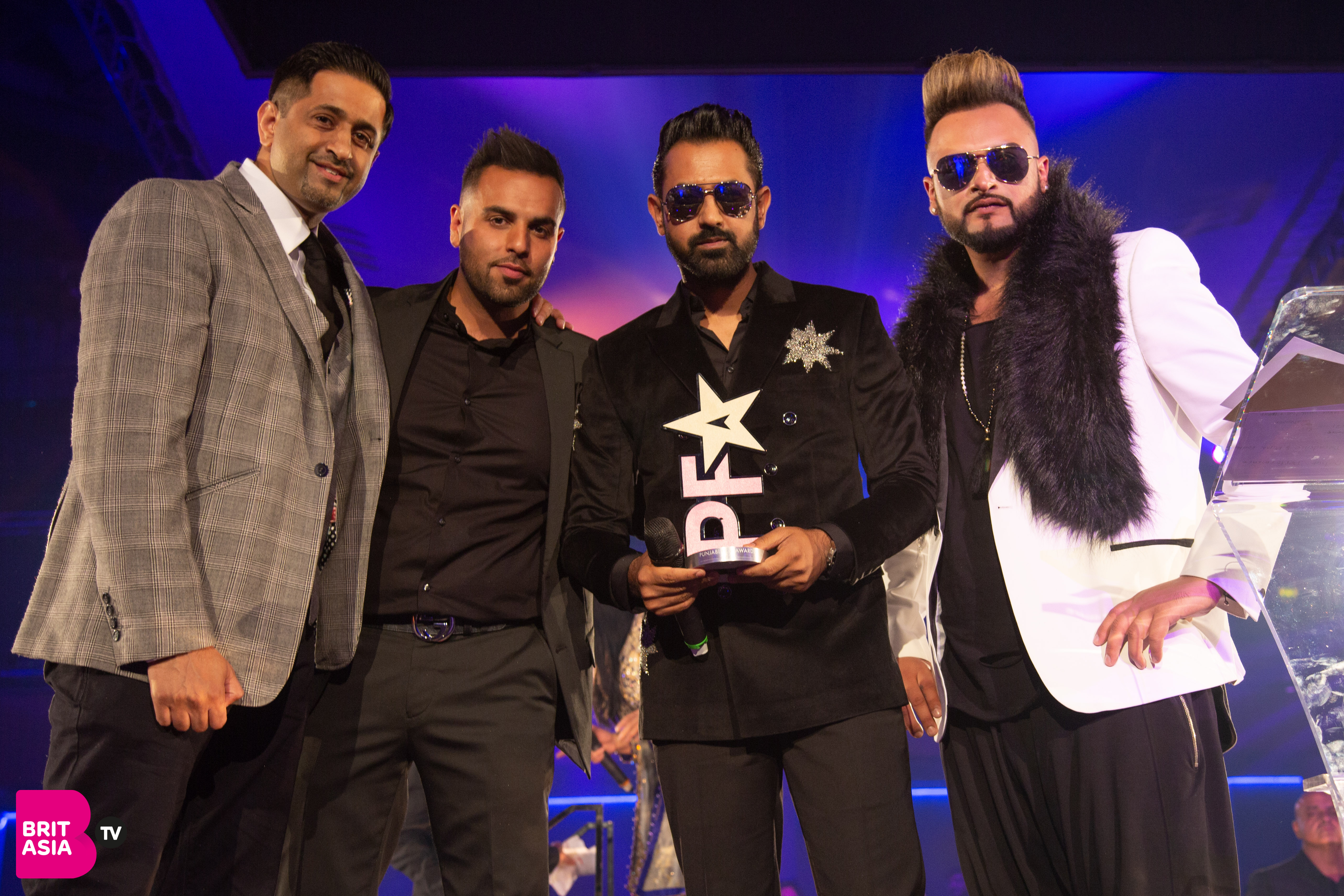 H Dhami, Gurj Sidhu and sponsor Snap Fitness 24/7 present the award for Best Film Song