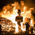 Guy Fawkes figuire being burnt at a bonfire