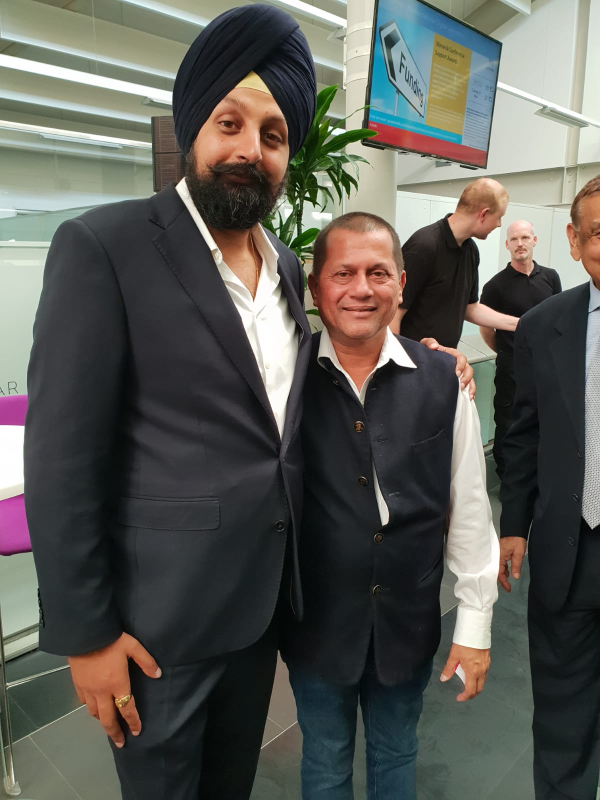 CEO of BritAsia TV, Tony Shergill, with Dr. Achyuta Samanta