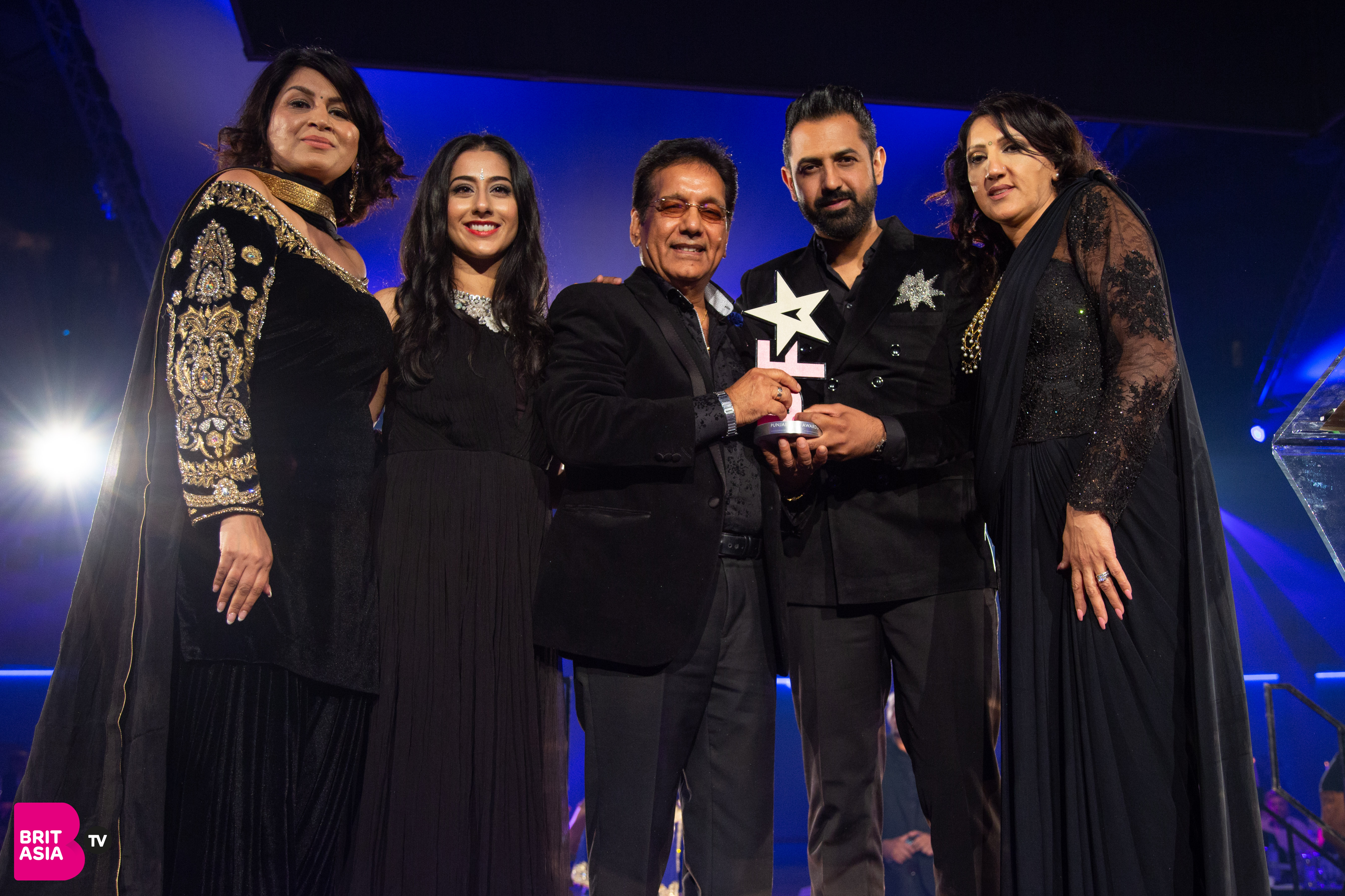 Gippy Grewal collects his award for Best Actor by sponsor Seva Care and Channi Singh OBE