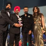 Gurpreet Ghuggi collects the Lifetime Achievement Award, presented by Gippy Grewal, Noreen Khan and CEO of BritAsia TV, Tony Shergill