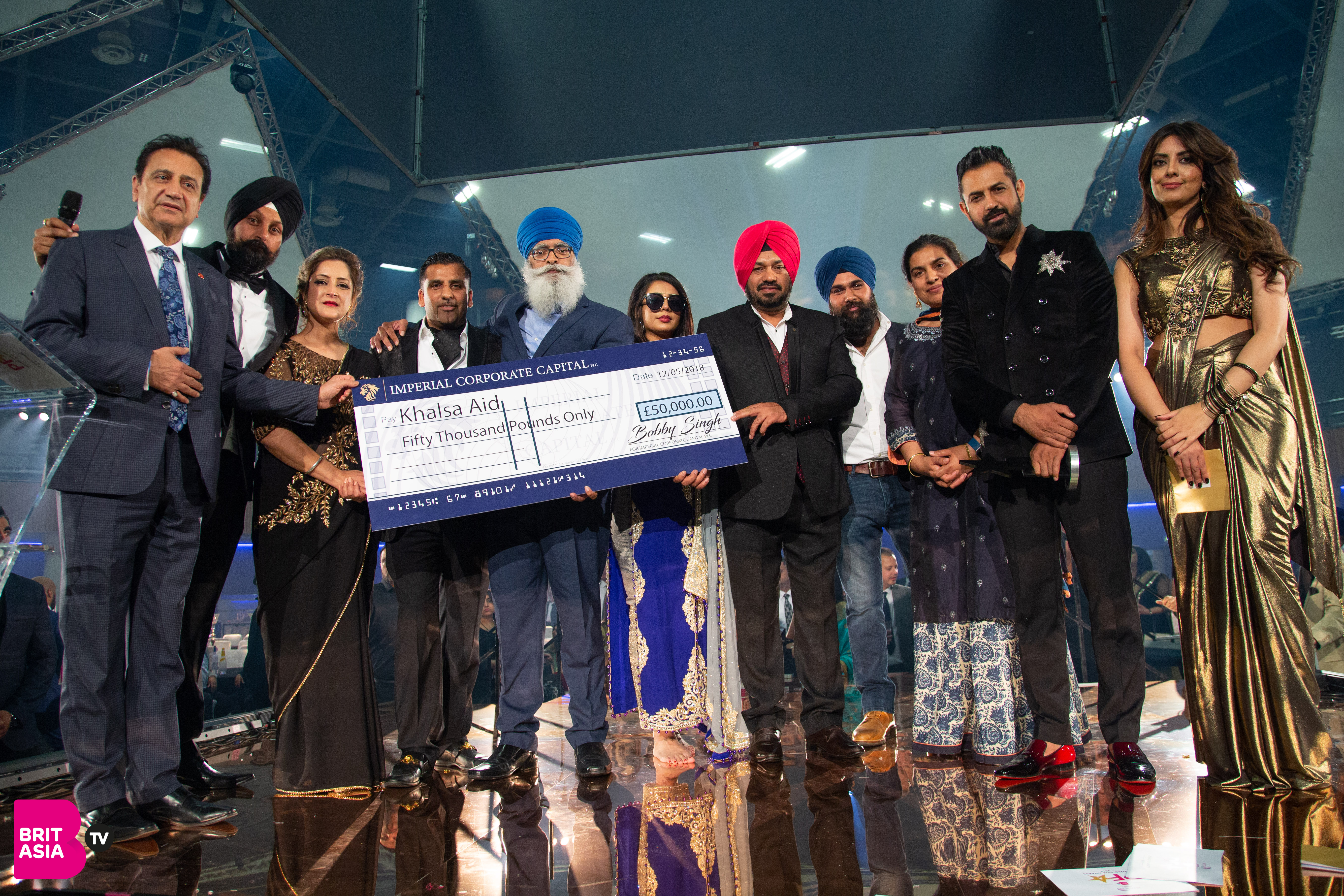 Ravi Singh CEO of Khalsa Aid, presents a cheque for £50,000 from imperial Capital chairman Bobby Singh