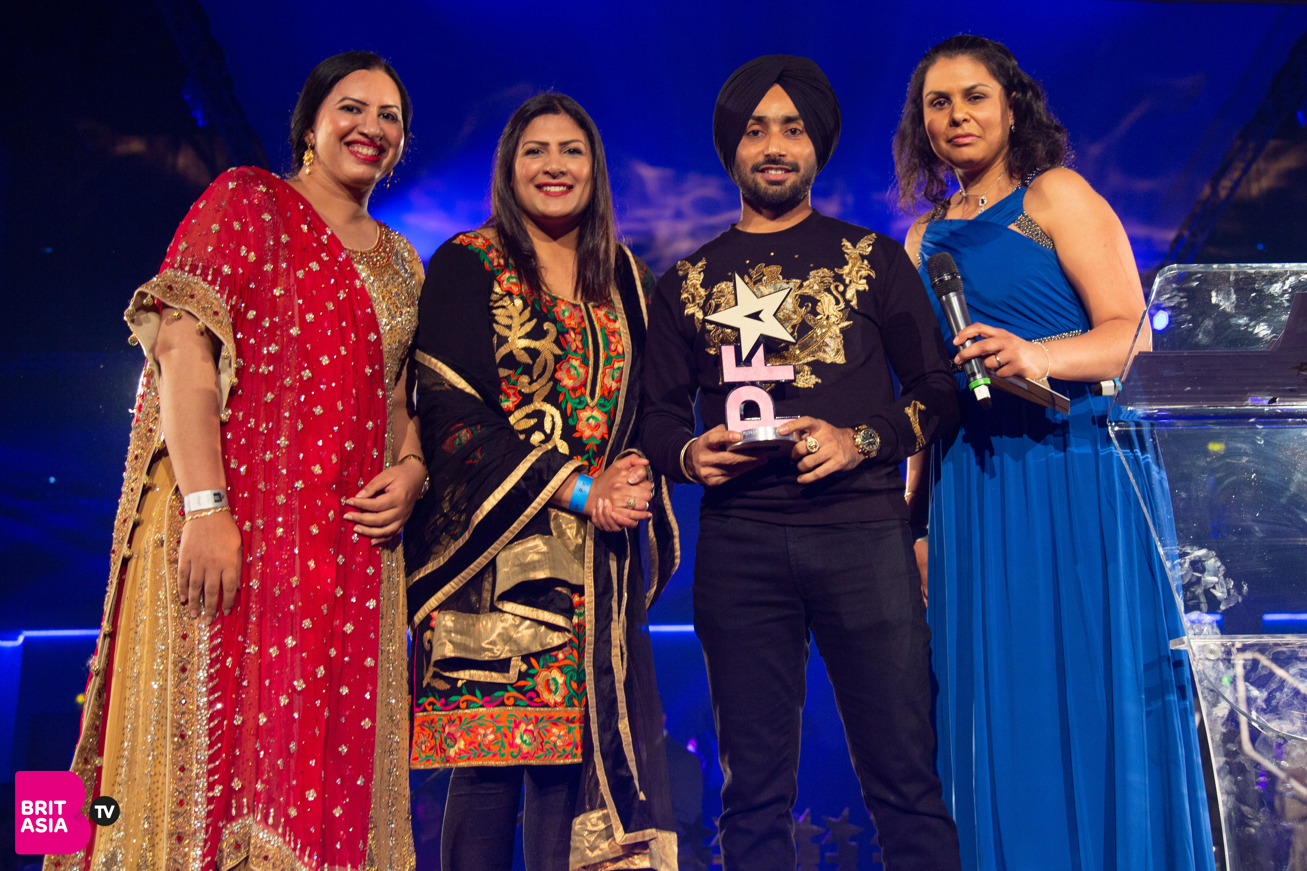 MP Preet Gill with sponsors West Midlands Police presenting an award to Satinder Sartaaj for Outstanding Achievement